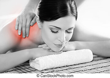 Portrait of a woman relaxing on a spa massage - Healthy...
