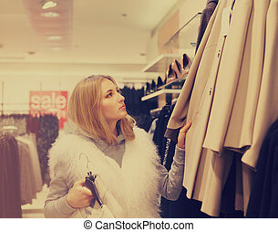 Portrait of a woman shopping in retail store