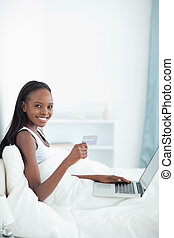 Portrait of a woman shopping online