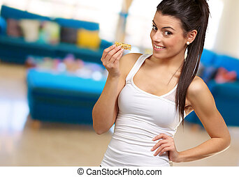 Portrait Of A Woman showing Granola Bar, indoor