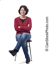 portrait of a woman sitting on a chair in white background, arms and legs crossed