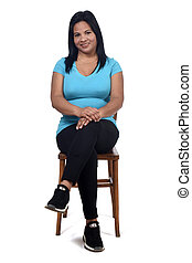 portrait of a woman sitting on a chair in white background, front view and legs crossed