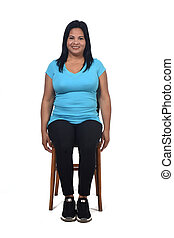 portrait of a woman sitting on a chair in white background, front view