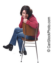 portrait of a woman sitting on a chair in white background