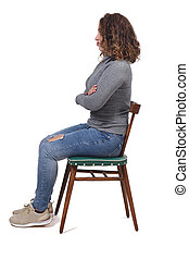 portrait of a woman sitting on a chair in white background,