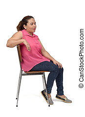 portrait of a woman sitting on a chair with the body in profile and look side on white background,