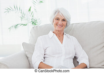 Portrait of a woman sitting on a couch