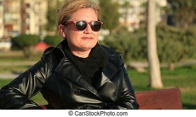 Portrait of a woman sitting on park