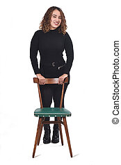 portrait of a woman standing with chair in white background,