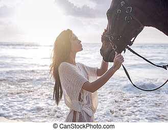 Portrait of a woman stroking the stallion