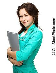 Portrait of a woman wearing doctor uniform - Portrait of a ...