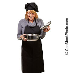 Portrait Of A Woman While Cooking Food