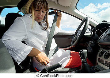 portrait of a woman with a seat belt in the car