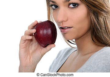 portrait of a woman with apple