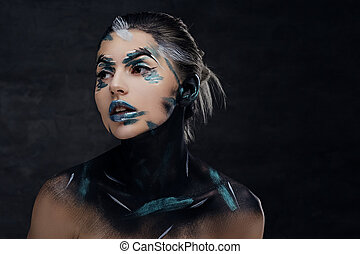 Portrait of a woman with artistic make up.