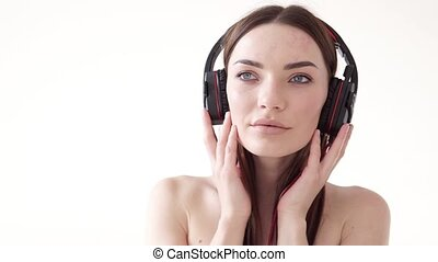 Portrait of a woman with big headphones with music