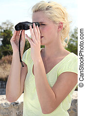 portrait of a woman with binoculars