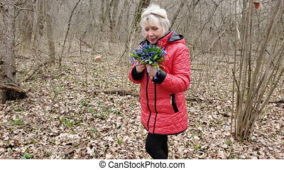 portrait of a woman with blue primroses