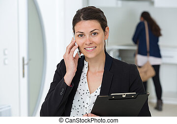 portrait of a woman with cell phone