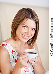Portrait of a woman with coffee