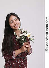 Portrait of a woman with flowers on white background