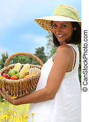 portrait of a woman with fruit basket