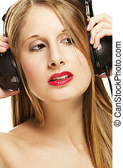 portrait of a woman with headphones listening to music