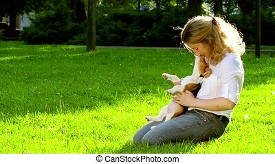 Portrait of a woman with her beautiful beagle  dog outdoors