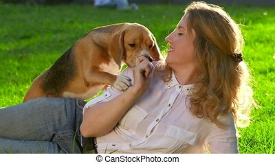 Portrait of a woman with her beautiful beagle  in park