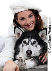 Portrait of a woman with her husky dog