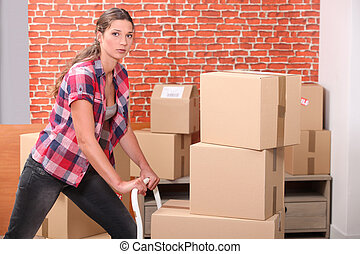 portrait of a woman with moving boxes