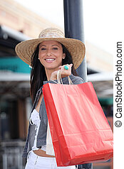 portrait of a woman with shopping bags