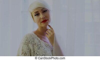 Portrait of a woman with short hair blonde smile 1