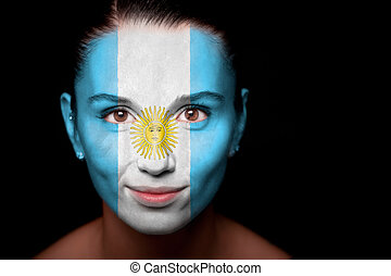 Portrait of a woman with the flag of the Argentine