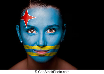 Portrait of a woman with the flag of the Aruba