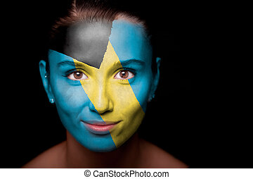 Portrait of a woman with the flag of the Bahamas