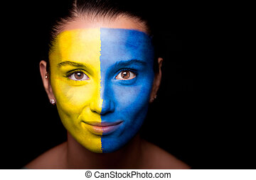 Portrait of a woman with the flag of the Ukraine