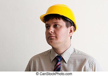 Portrait of a worker in a helmet