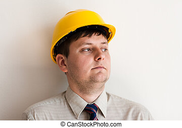 Portrait of a worker in a helmet