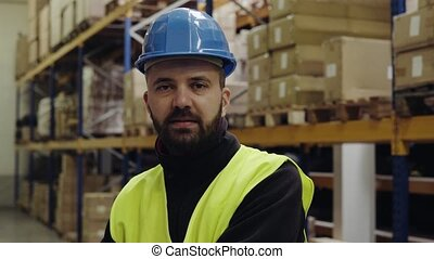 Portrait of a worker in a warehouse.