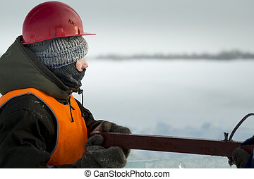 Portrait of a worker with a balaclava on his head in profile