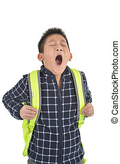 Portrait of a yawning schoolboy with backpack, isolated on white background