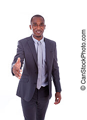 Portrait of a young African American business man greeting with a handshake gesture - Black people