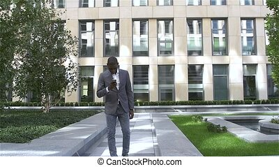American business man making a mobile  phone call - Black people, slow motion