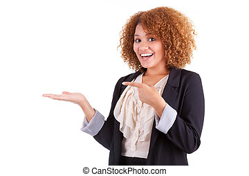 Portrait of a young african american business woman holding something in her hand palm, isolated on white background - Black people