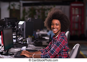 portrait of a young African American woman in modern office