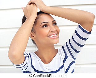 Portrait of a young and attractive latin woman smiling