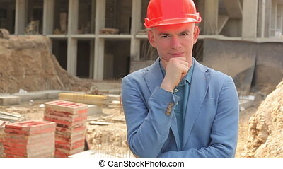 Portrait of a young architect at a construction site.