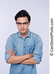 Portrait of a young asian casual man over white background