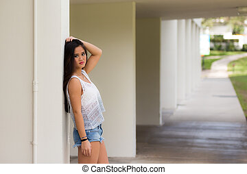 Portrait of a young Asian girl in jeans shorts